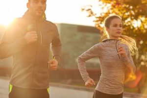 51225209 - fitness, sport, people and lifestyle concept - couple running outdoors