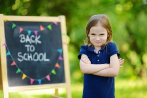 41378658 - adorable little schoolgirl feeling unhappy about going back to school