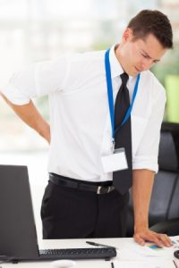 22538046 - businessman having lower back pain in office